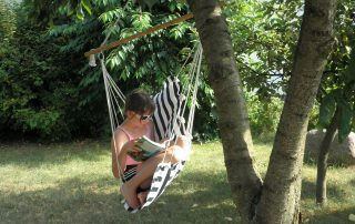 Girl reading in a hammock