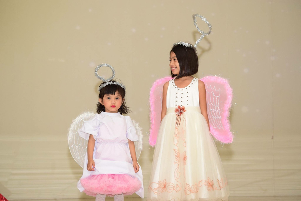 two girls dressed as angels for a nativity play