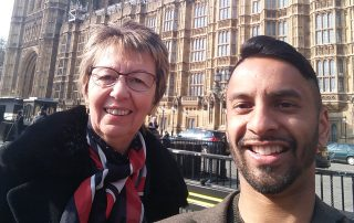 Julie Taplin, CEO of Potential Plus UK, with Bobby Seagull, outside the Houses of Parliament