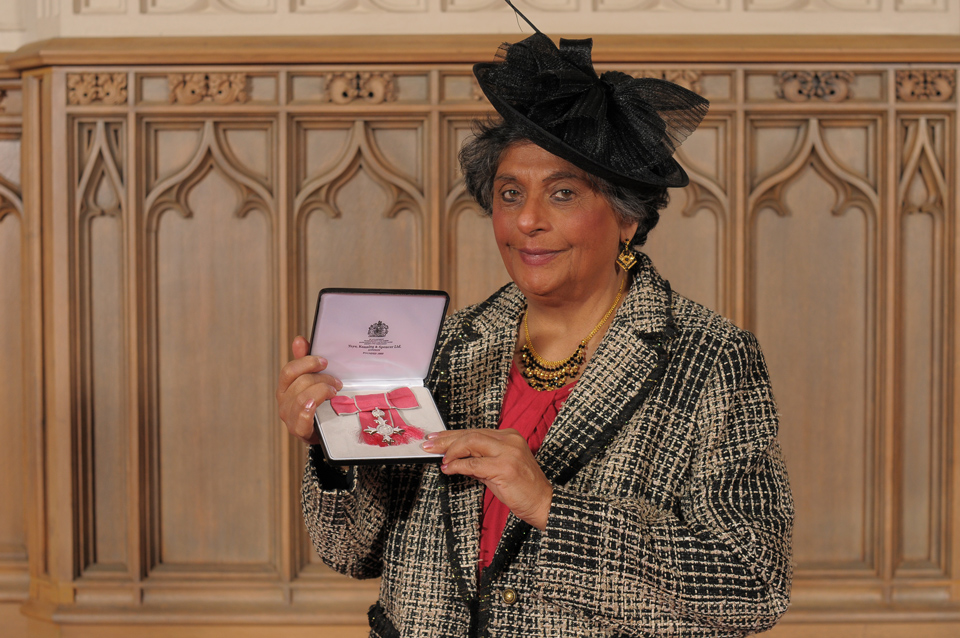 Professor Valsa Koshy holding her MBE awarded by the Queen March, 2019