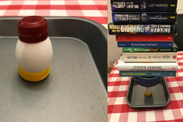 An egg supporting books