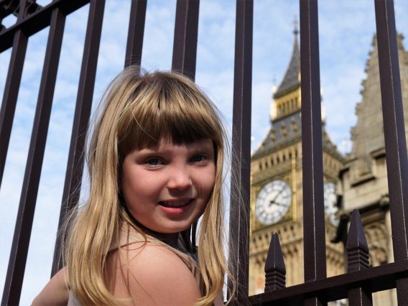 Girl outside the railings near Elizabeth Tower