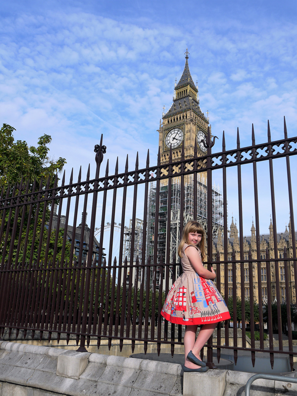 Girl looking at Elizabeth Tower, Houses of Parliament