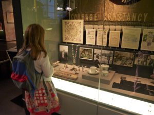 Gir standing in front of the Museum of London Suffragette Exhibit