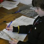 Boy codebreaking at the PPUK Be Curious Weekend 2019