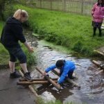 Oops - getting feet a bit wet trying out a bridge built with poles across a stream at the PPUK Be Curious Weekend 2019