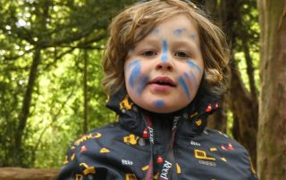 Young child with wode facepaint at the PPUK Be Curious Weekend