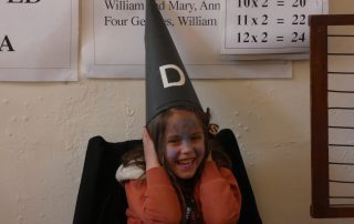 Girl trying out Dunce cap at the PPUK Be Curious Weekend 2019