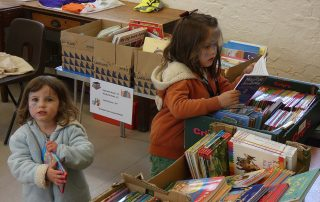 Books, Books, Glorious Books! - Children selecting from boxes of books at the PPUK Be Curious Weekend, 2019