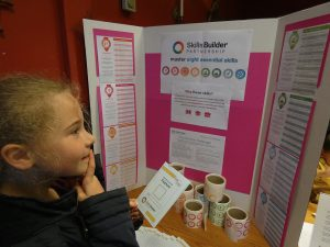 Girl checking out which Skills Builder skills she has done in her activity. At PPUK Be Curious Weekend 2019