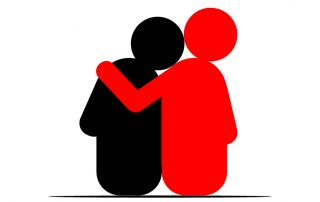 Two figures sitting next to each other in an empathetic hug
