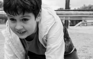 Black and White photo of boy crawling on outdoor activity