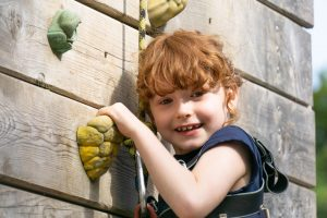 Young girl on a climbing wall