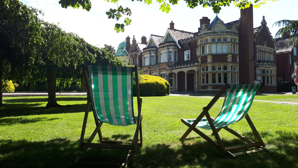 2 deckchairs in the sunshine in front of The Mansion, Bletchley Park