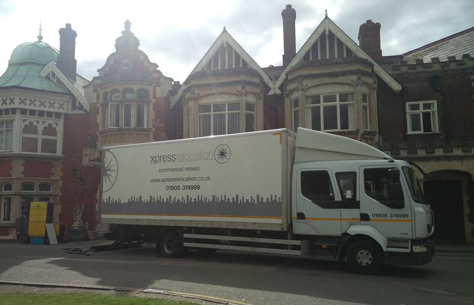 Moving van parked outside of The Mansion Bletchley Park