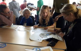 Family group taking part in Potential Plus UK's Operation Squirrel at Bletchley Park 2019