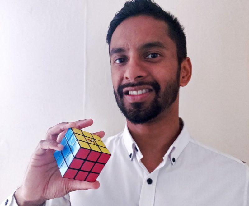 Bobby Seagull holding a Rubik's Cube