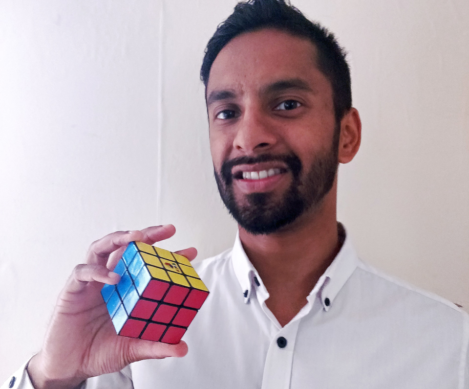 Bobby Seagull holding a Rubik's Cube