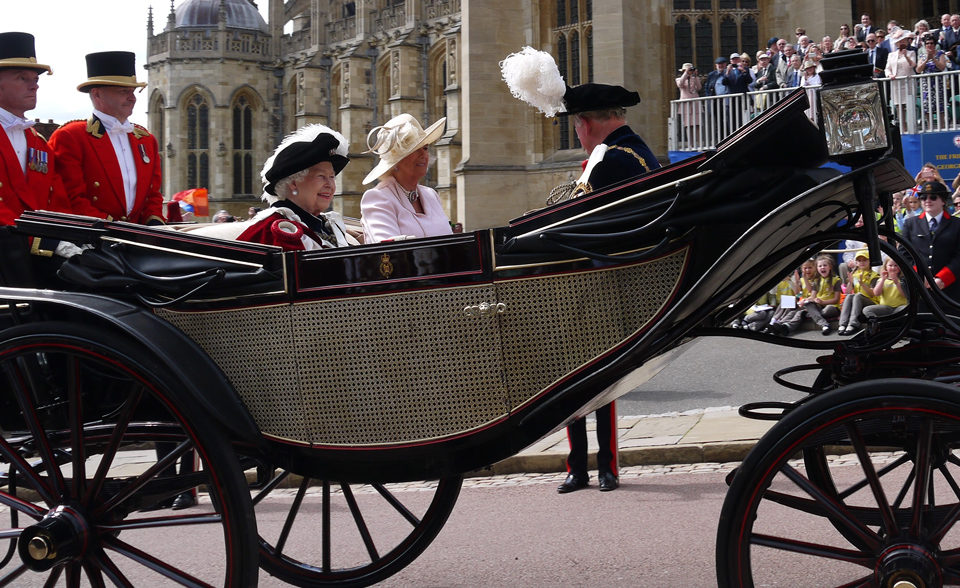 The Queen, Prince Charles and Camilla, Duchess of Cornwall riding in a carriage at Garter Day 2019