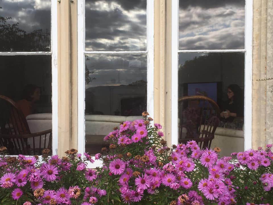 Hawkwood College Window with Michaelmas Daisies outside it