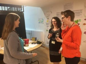 Rebecca Howell talking with a parent and volunteer at Potential Plus UK's BIG Family Weekend, 2019