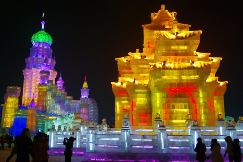 Ice sculture of an oriental palace lit up with festive colours
