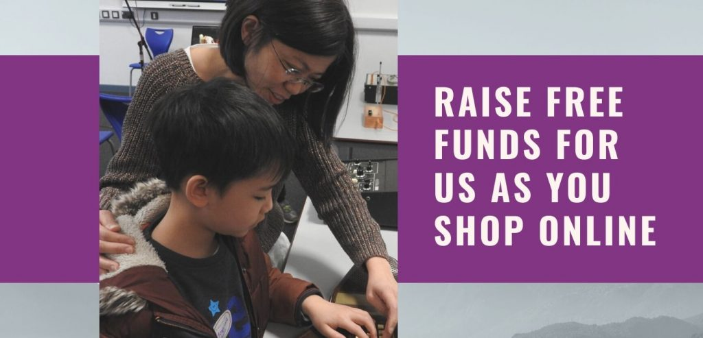 mother and child examining a machine. Words: Raise funds for us as you shop online