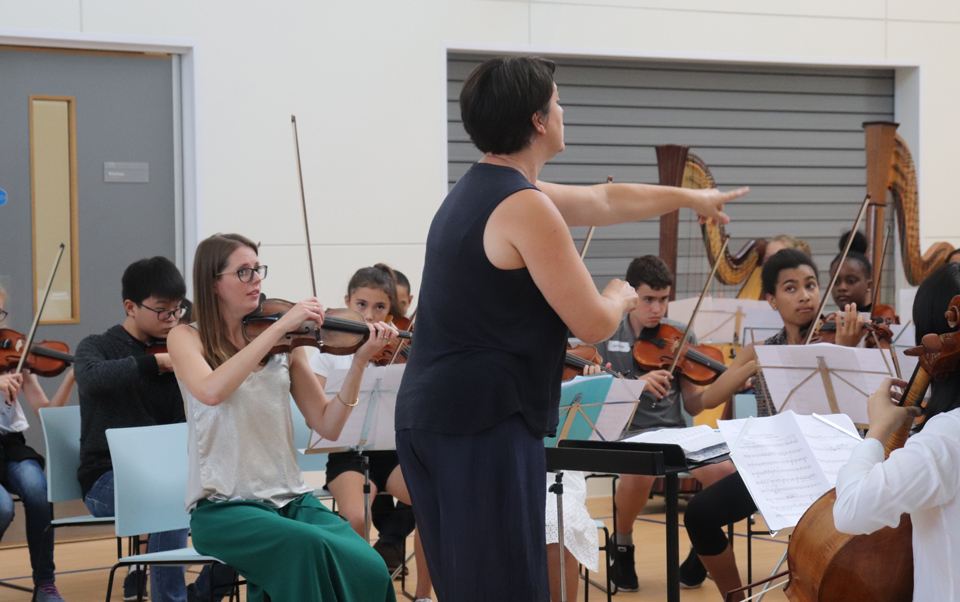 LPO Junior Artist: Overture Project - conductor and orchestra with participants playing music
