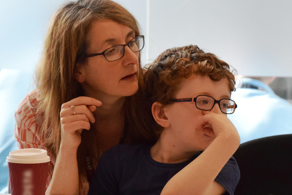Parent and child concentrating together