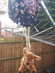 Fawn toy hanging from a parachute