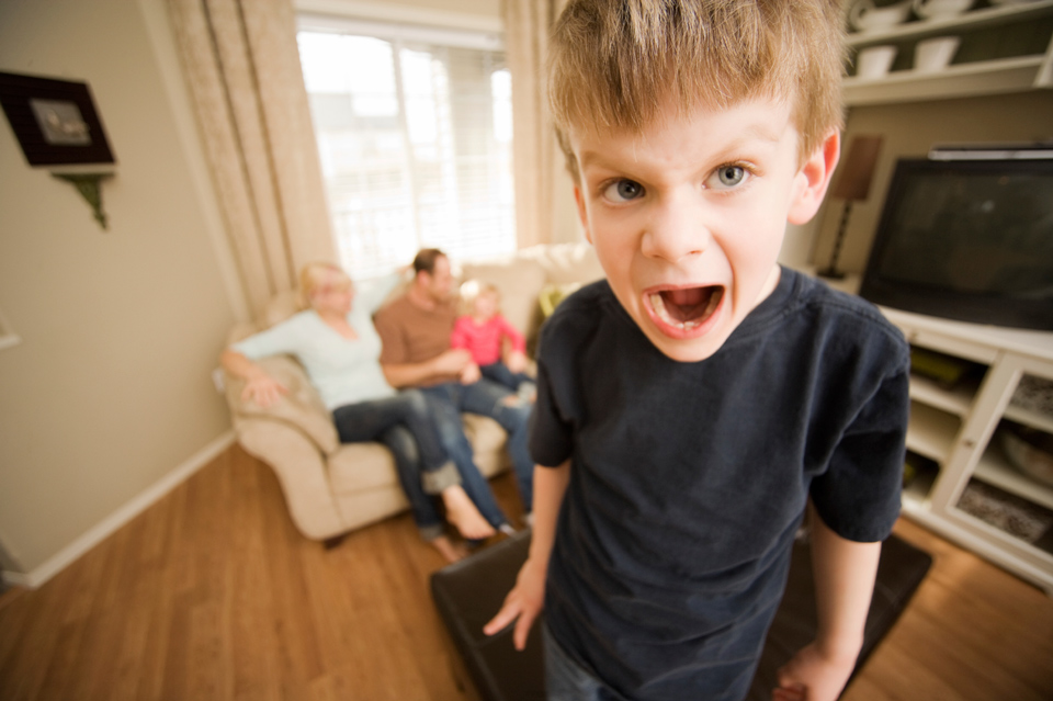 A young boy screaming
