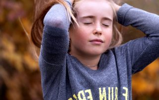 Girl with hands on her head in disbelief or disappointment