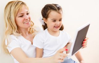 Mother and young child looking at a tablet