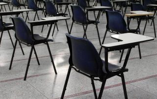 School hall, empty except for chairs set out for exam