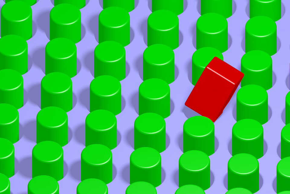 red square peg on board of green round pegs