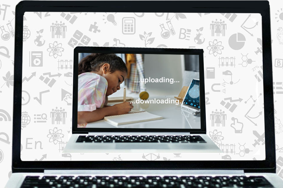 A computer screen, with picture of a girl pictured within a computer screen working off a laptop