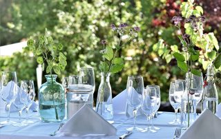 Outdoor table set with glasses for a party