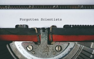 Typewriter close up to read Forgotten Scientists on the paper