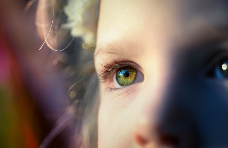 Soft focus close up of child's face with emphasis on right eye