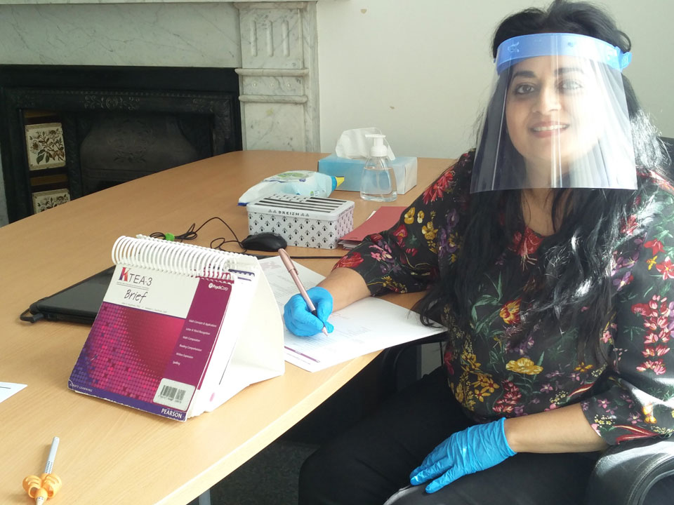 Radhika Rajbans in PPE before an assessment
