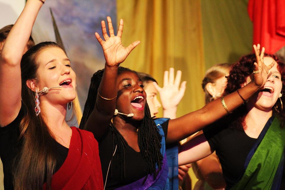Teenagers singing on stage