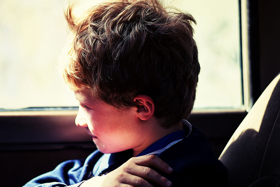 boy in car looking out of window