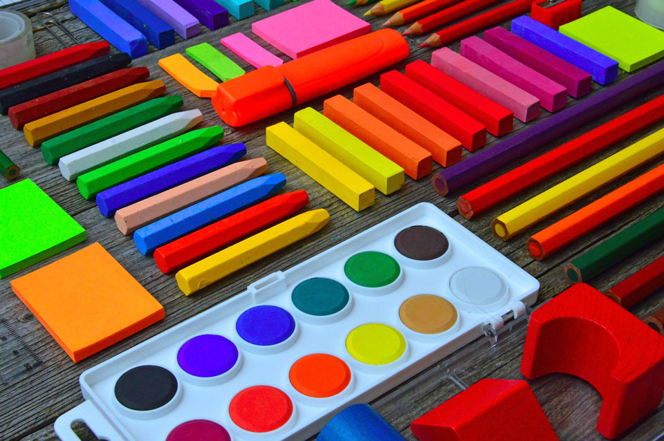 Colouring pencils, pastels, paints lined up