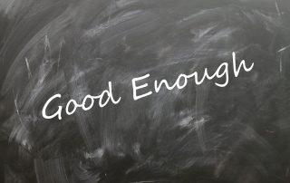 the term Good Enough written in script across a chalkboard