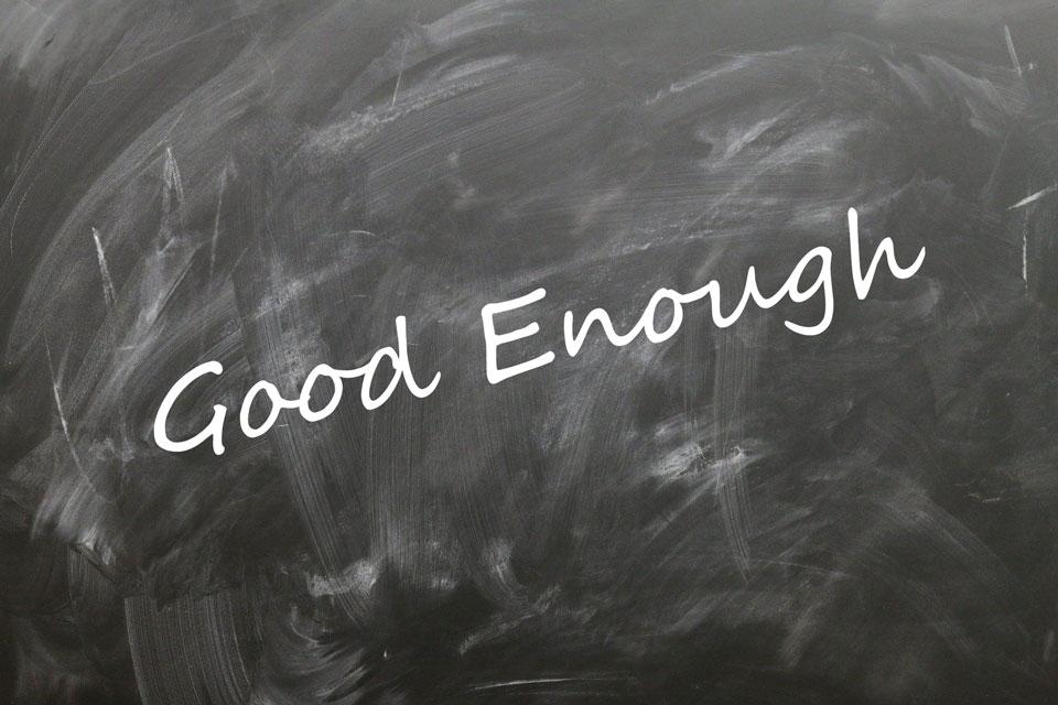 the term Good Enough written in script across a chalkboard