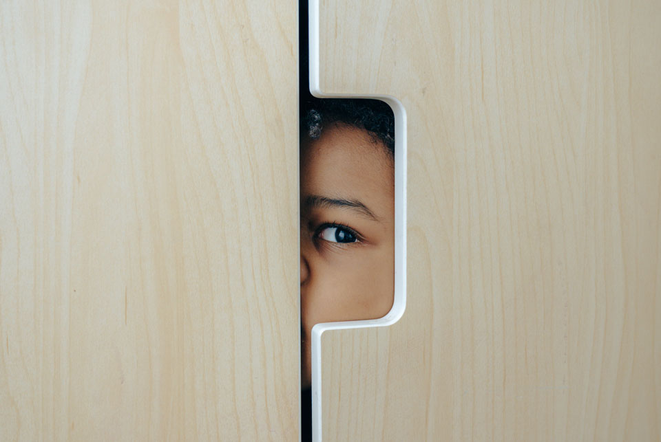 Child's eye looking out of a wardrobe