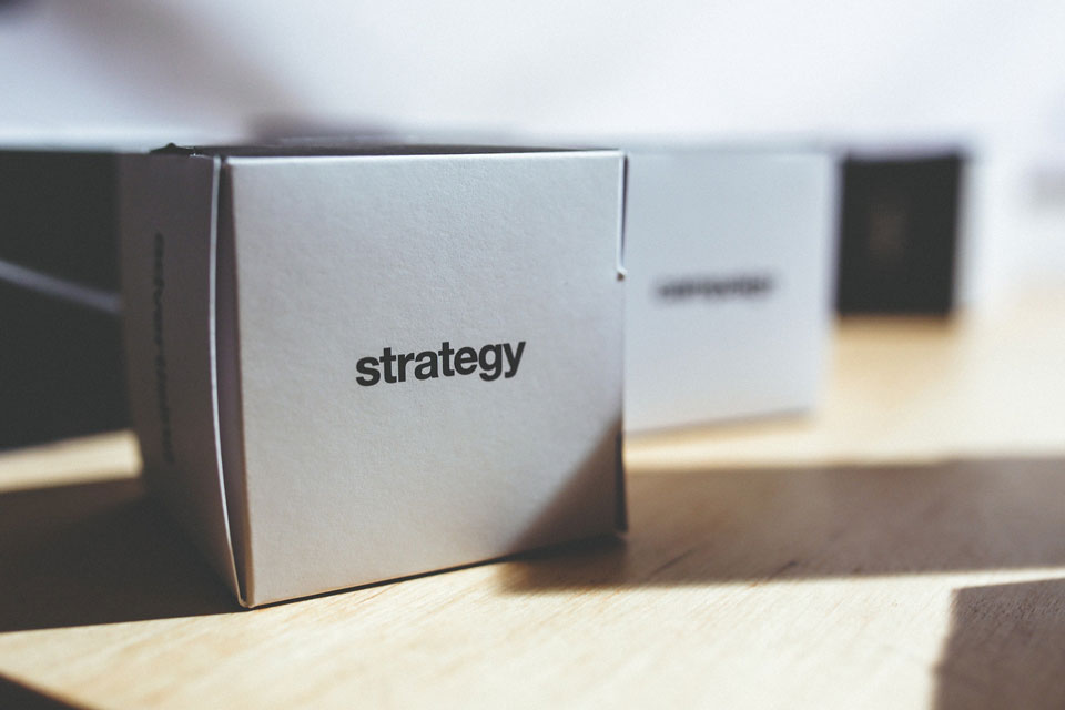 Boxes marked as strategy standing on a table