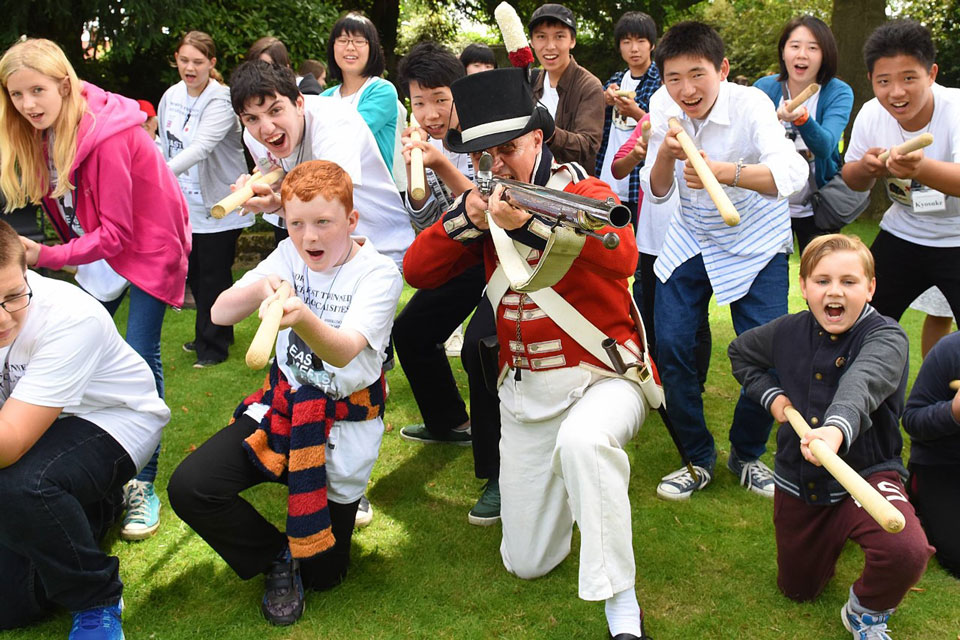 Nigel Amies and young people in historical military re-enactment. Photo Credit: Norfolk Museums Service