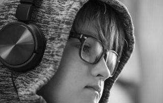 boy in a hoodie with headphones