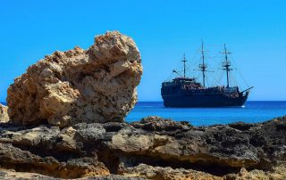 Old fashioned pirate ship seen from the shore in Cyprus